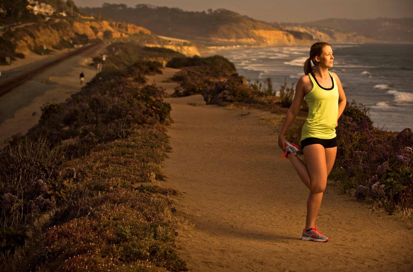 Woman running along ocean